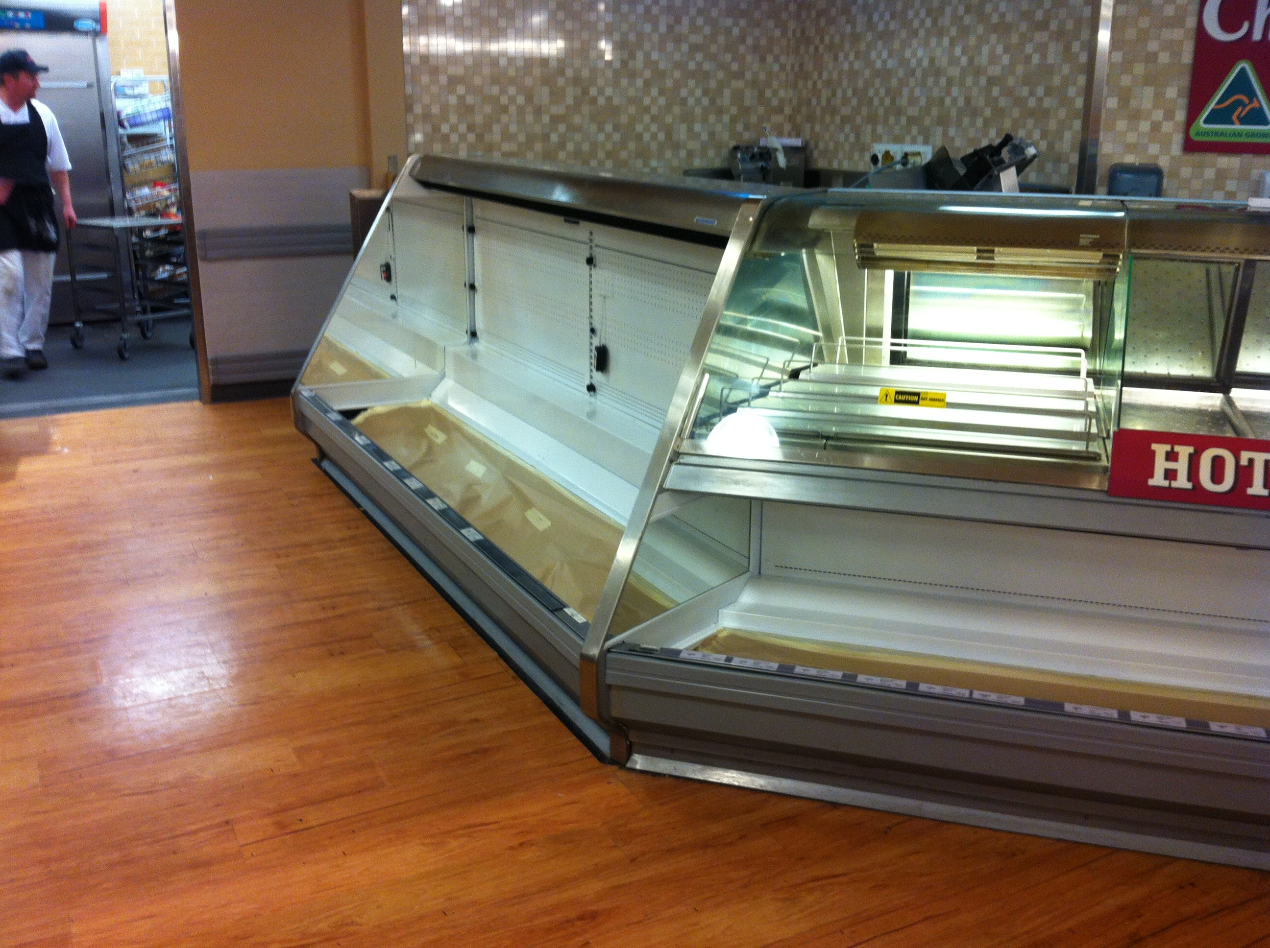 Progress photo of Deli case with electrostatic spray and fabrication works completed onsite